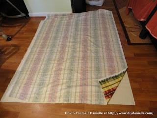 Two different fabrics faced right sides together to make a picnic blanket.