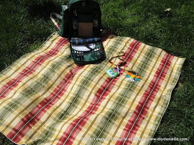 Completed DIY picnic blanket with picnic backpack on top.