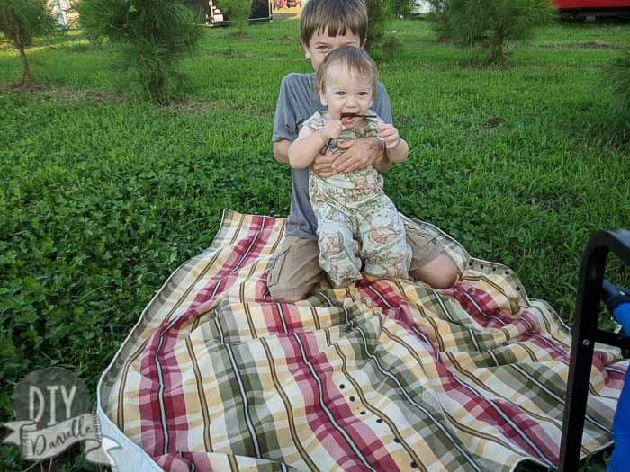 DIY Picnic blanket with two of my sons sitting on it.