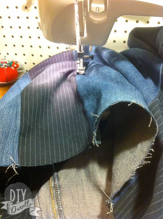 Top stitching the strips of jean fabric.