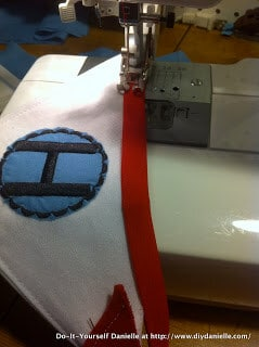 Using bias tape to sew the banner together.