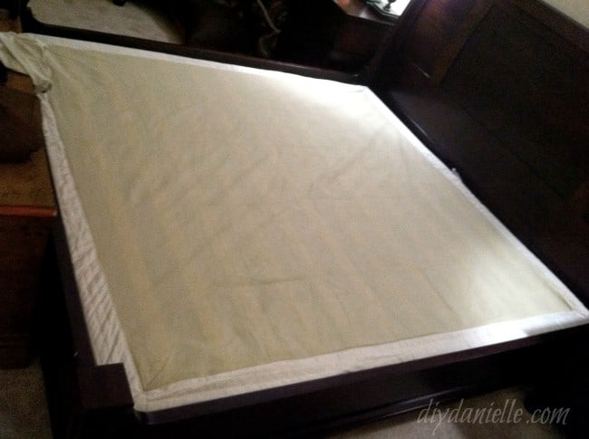 Fabric cover over wood box spring kit.