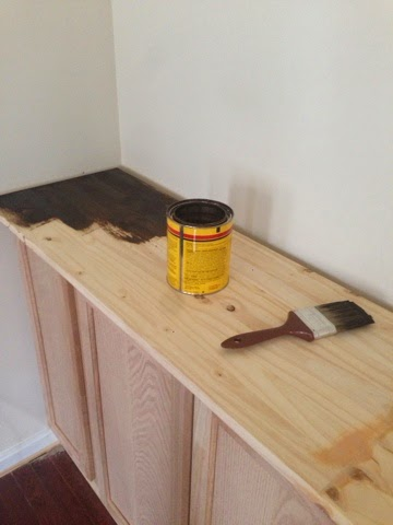 Staining the wood countertop.