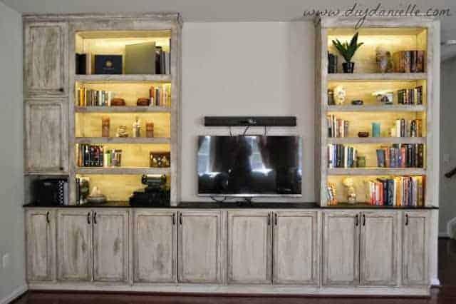 Built In bookshelves, storage, and entertainment center: lights on.