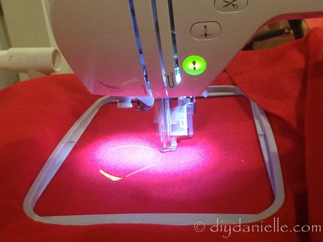 Embroidering a patch for a superhero cape. You can also use an iron on patch.