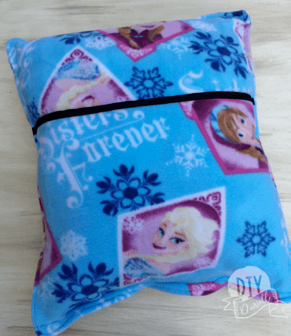 Fleece pillow with Frozen fabric with a pocket added to tuck a book inside.