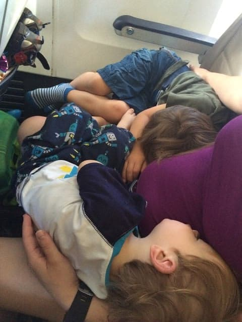 When traveling with kids, choosing a good flight time is important for a peaceful trip. Kids sleeping on a late flight.