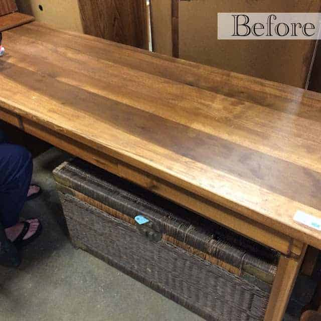 Before Picture: How to repurpose a table into a gaming table and desk. This upcycle involves distressing the furniture piece, installing gaming felt (poker table cloth), adding a wood edge around the table, adding a top for the table, and using mod podge