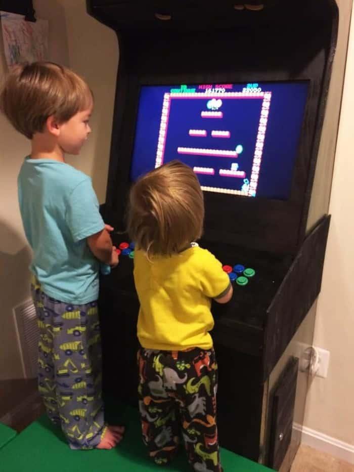Kids playing on DIY arcade machine