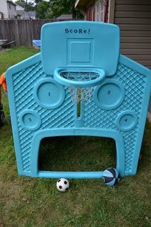 Basketball hoop and soccer goal on a plastic playhouse.