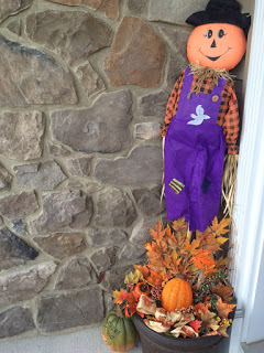Scarecrow and wreath setup with an old planter for my Fall front porch.