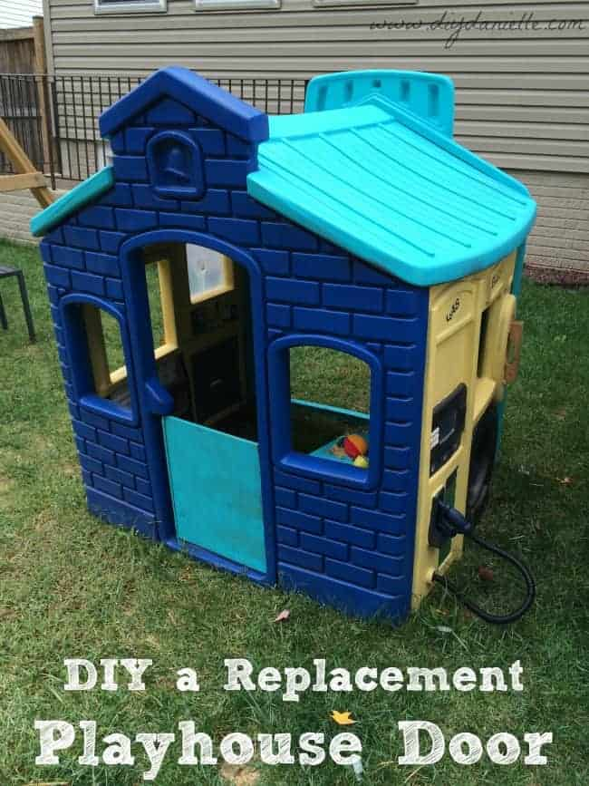 This is our completed playhouse, painted and with the replacement door installed!