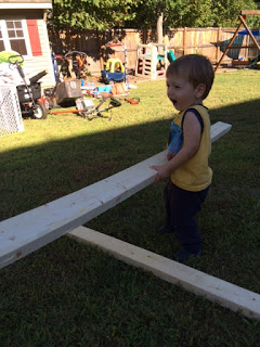 How to build shed shelving: my son helping. #woodworking #storage #organization