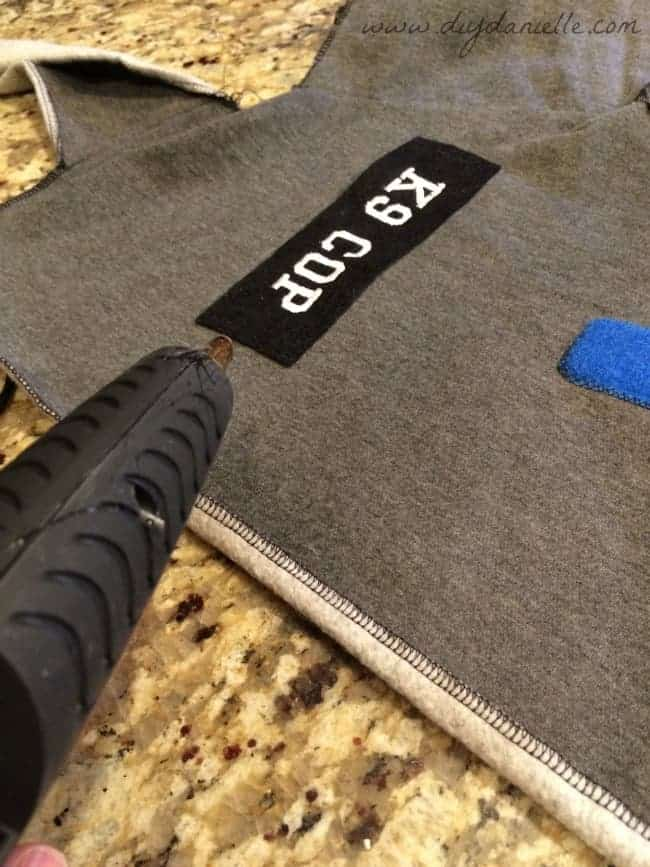 Create a patch for your vest and glue it on.