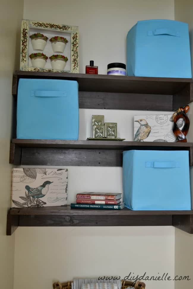 Close up of our small bathroom shelving and decor.