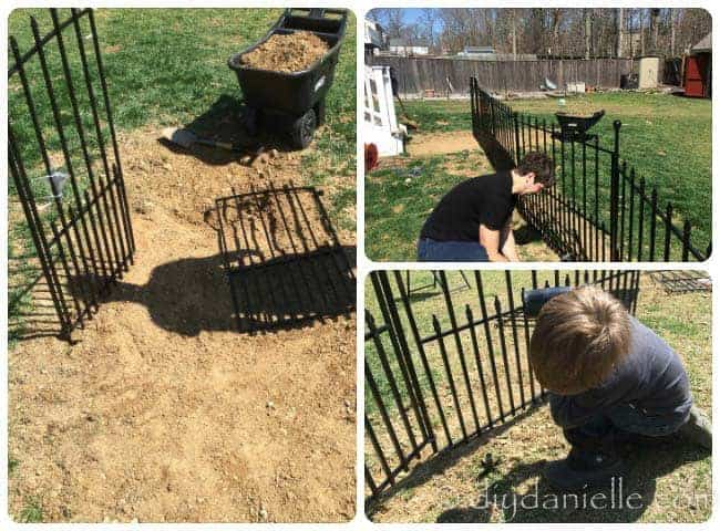 Installing the dog fence and gate for the DIY dog run.