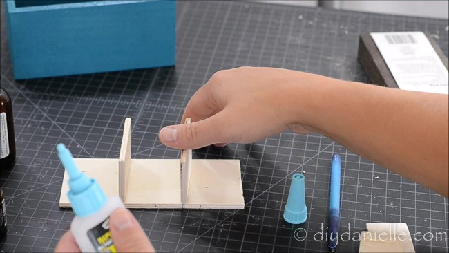 Use glue to hold the pieces of wood in place. Let dry.