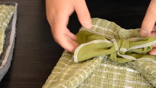 Tied ribbon closing a reusable bread bag.
