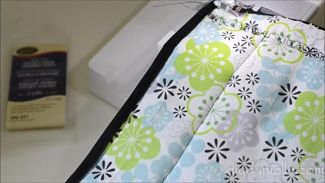 Sew on bias tape to your hot pad.