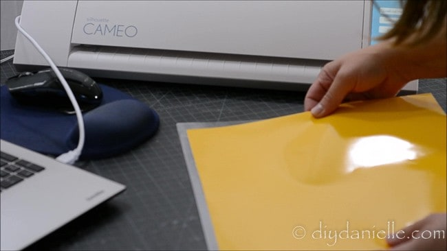 Putting 631 vinyl on a cutting mat for the Silhouette machine.