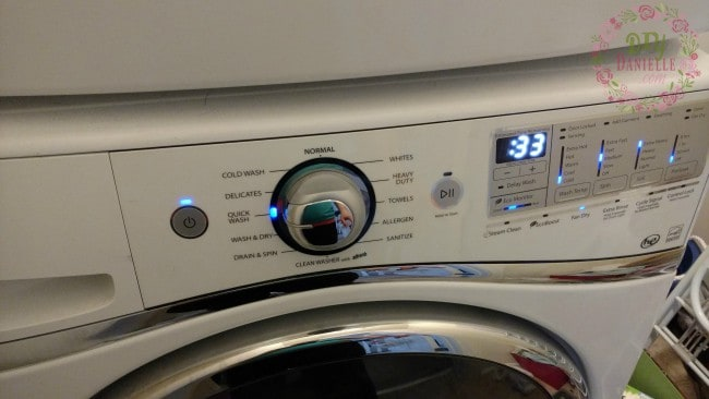 Turn on your washing machine so it will clean the bath toys for you.