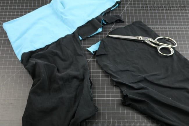 Cut off the pant leg of the upcycled yoga pants.