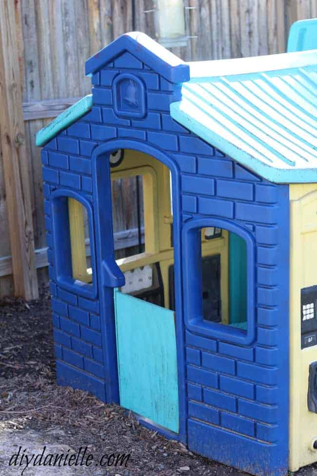Blue paint lasted longer than the other colors on this painted plastic playhouse.