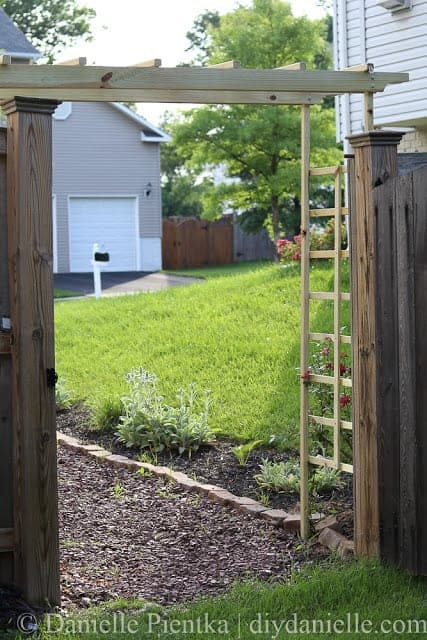 DIY Garden Arbor over a stone path.