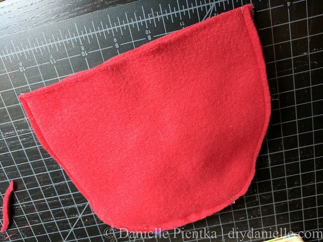 Sew baby hat closed, right sides together, then trim excess fabric. Turn right sides out.