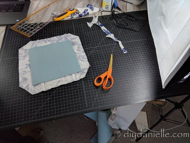 Cutting fabric and a yoga mat to make a mousepad.