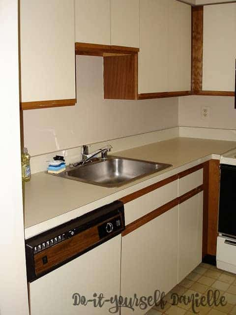 Laminate cabinets and counters in a small condo kitchen.