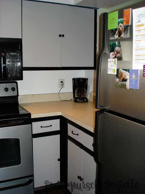 Painted laminate cabinets in gray and black.