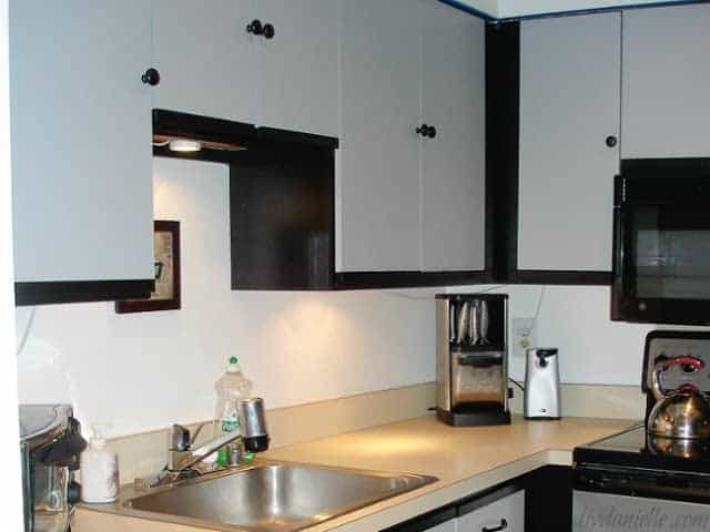 Laminate cabinets painted black and gray.