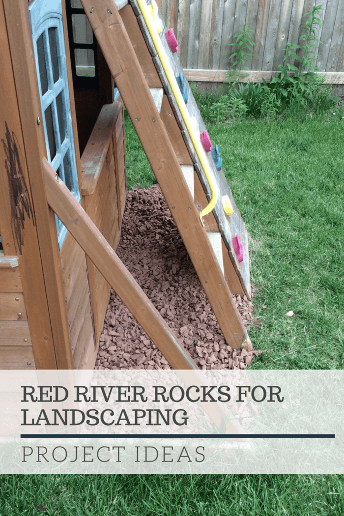 Project ideas for red barn rock. This shows red barn rock as a grass barrier around a swing set.