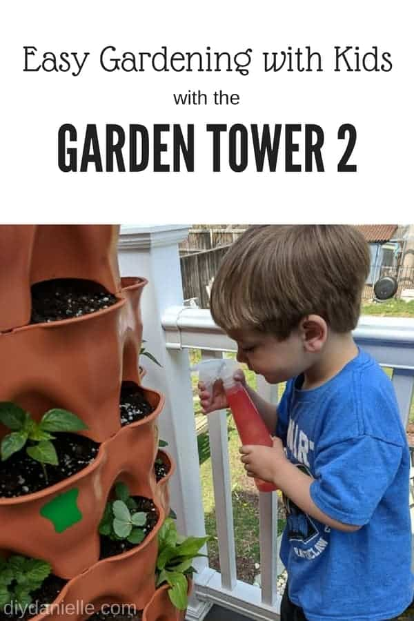Gardening with kids in the Garden Tower 2. This vertical container garden makes it easy for kids to help with watering and planting. Photo: Child watering his plants.