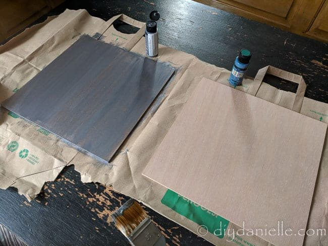 Painting 12x12 art boards for nursery decor signs.