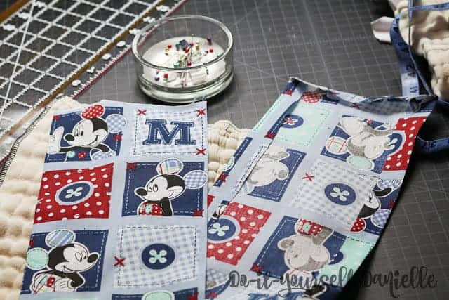 Cotton fabric strip for making a burp cloth from a cloth diaper.
