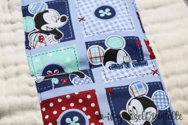 Cotton fabric overlapping on an embellished burp cloth.