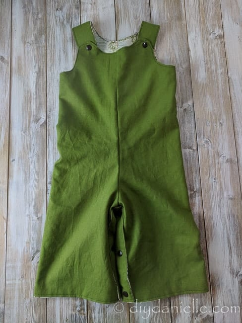 Green side of the Winnie the Pooh reversible romper.