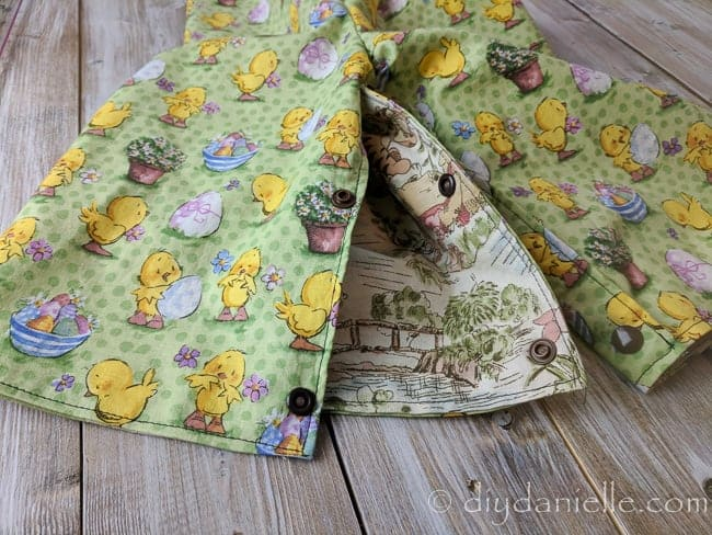 Easter fabric on one side of the reversible romper, Winnie the Pooh on the other. Leg unsnapped.