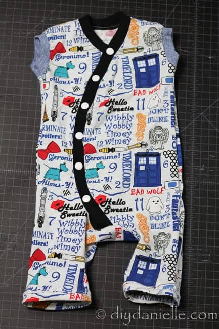 Muse baby playsuit made with Doctor Who fabric. Sleeveless.