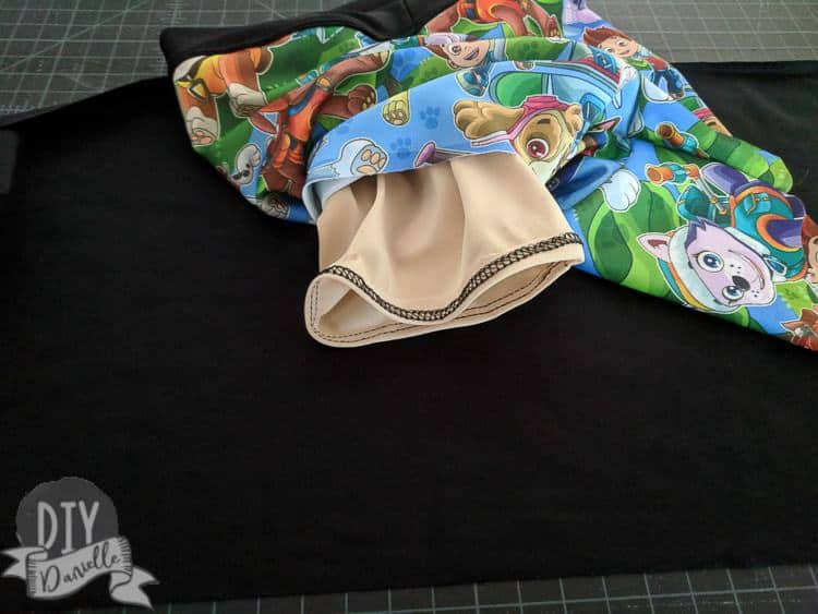 Inner liner for the swim shorts. The bottoms for the legs are finished with a coverstitch machine.