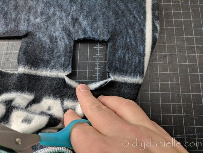 Cut diagonal snips for each corner of the square.