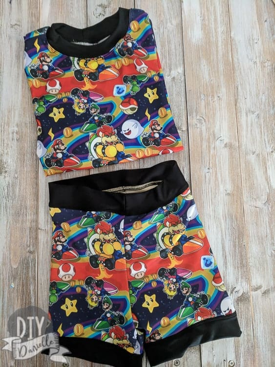 This bathing suit set was made with a rashguard and swimmers pattern. Get my tips and adjustments here. Mario Kart Swim Shorts and Rashguard set.