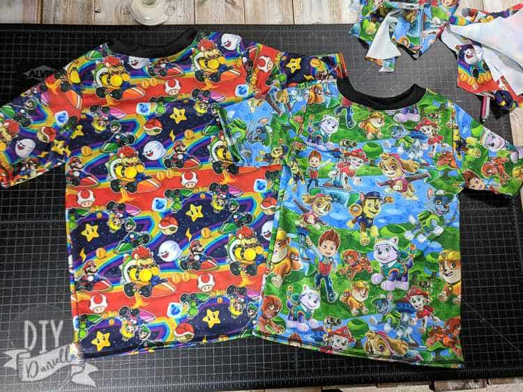 DIY Rashguards with Paw Patrol and Mario Kart fabric. The Rashguard Pattern is Swimmers from Boo! Designs.