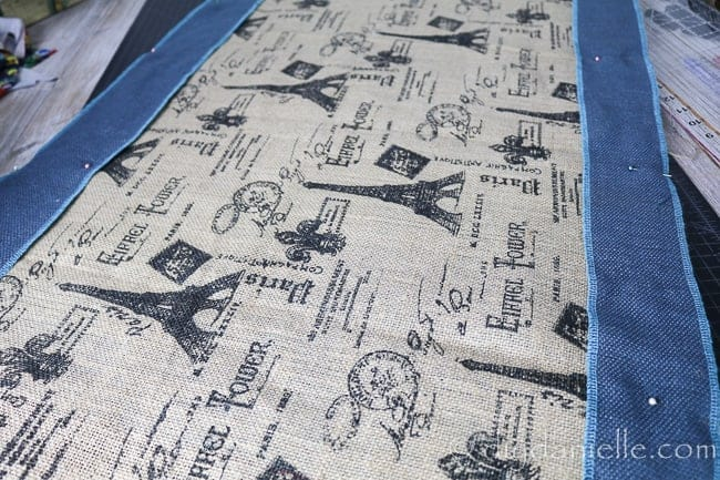 Pinned burlap fabric to make a serger mat.