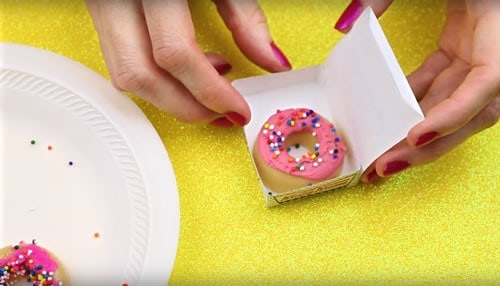 Donut shaped lip balm in tiny donut boxes.