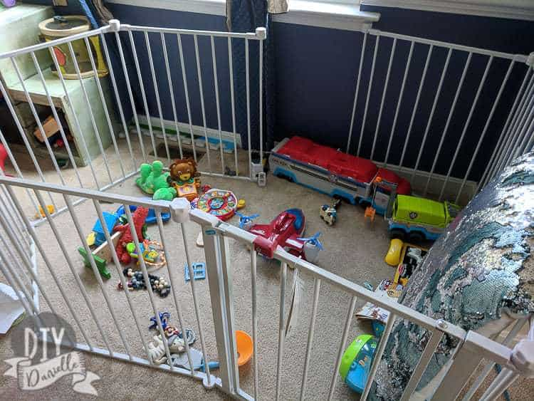 Lots of small toys everywhere in the playpen for the baby.