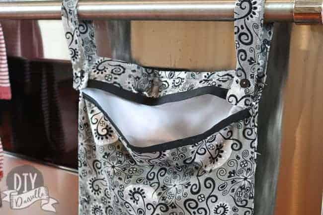 A kitchen wet bag with a PUL interior and a cotton exterior. No zipper.