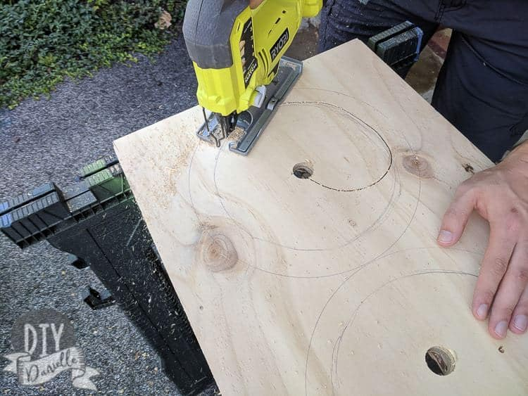 Cutting out the hole for the dog bowls with a jig saw.